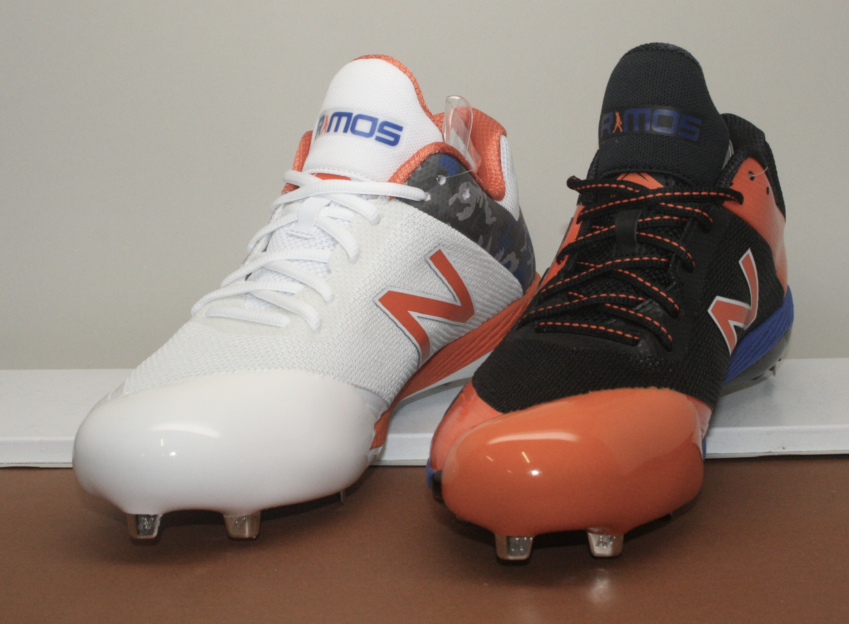 "<img src=""NB_orange_and_white_pitching_toes.jpg"" alt=""New Balance pitching toe pitching toes""/>"